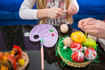 Preparing for Easter by painting eggs, Happy Easter.