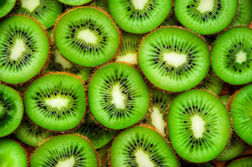 Juicy green round pieces of kiwi on the surface