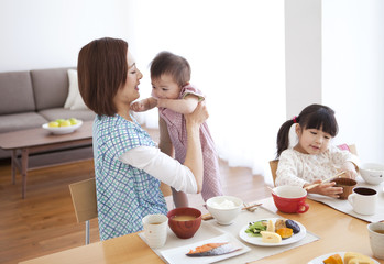 Mother with Two Children Having Breakfast