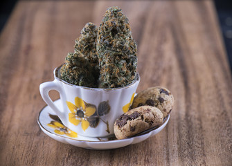 Cannabis nugs and infused chocolate chips cookies - medical marijuana edibles concept