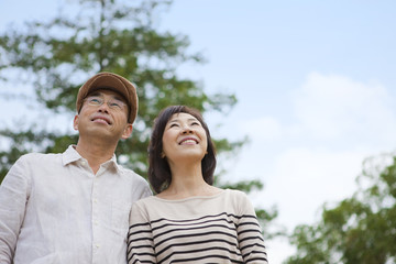 Mature couple looking up