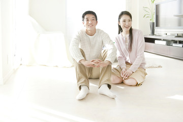 Mid Adult Couple Sitting on Floor