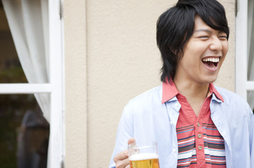 Young man holding a mug of beer