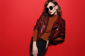 fashion model in sunglasses, beautiful young woman. leather jacket, studio shot Wall mural