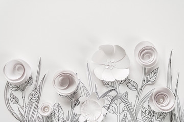 3d paper flowers with painted leaves and stems on the white background
