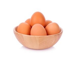 Eggs in wooden bowl isolated on white background