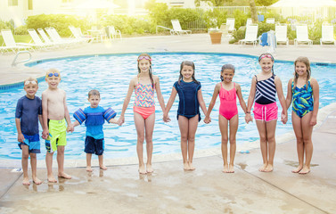 Group of Children playing together at the swimming pool