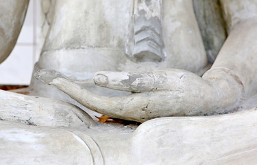 Close up hands of buddha statue