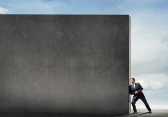 Businessman push wall