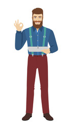 Hipster holding digital tablet PC and show a okay hand sign