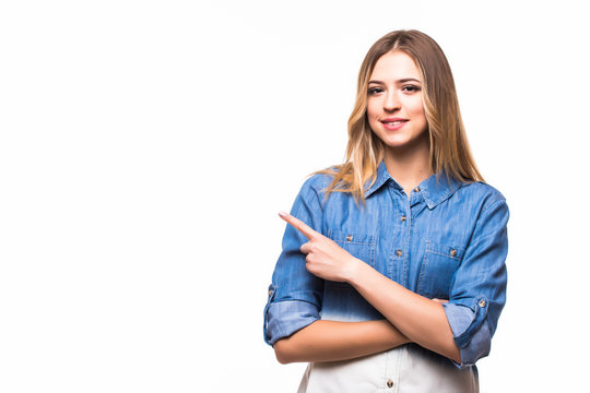 casual young woman pointed side with a smile isolated on white background