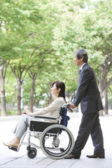 Senior man with wife in wheelchair
