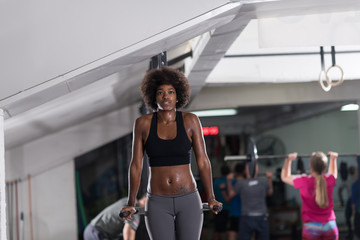 black woman doing parallel bars Exercise