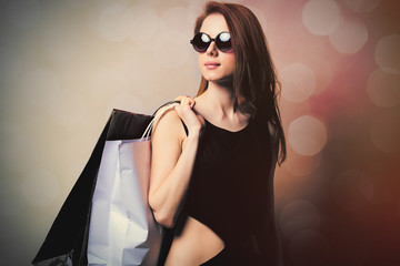 beautiful young woman with shopping bags on the wonderful white background