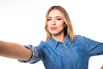Portrait of a smiling cute woman making selfie photo on smartphone