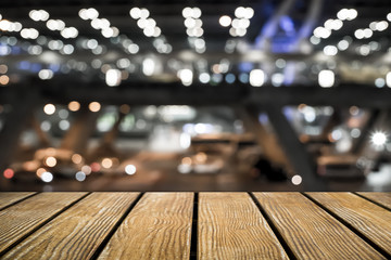 Empty Old Wooden table with city background .