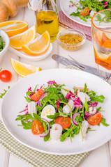 Salad with arugula, squid, cherry tomatoes, onion and quail eggs