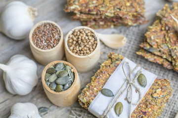 Healthy snack: cereal crunchy multigrain cereal flax seed pumpkin, coriander, sunflower seeds protein bread bar. Protein albumen source. Salted diet crispy crackers. Wholemeal.