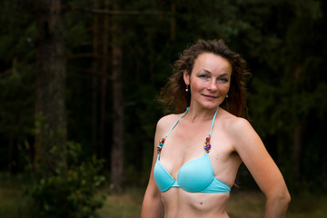 Girl in bathing suit in the forest