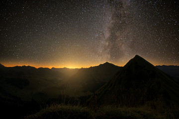 The milky way above the mountains before sunrise. Stars on the colorful night sky.   Stockfoto-ID: 377918110