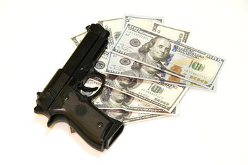 Black gun and one hundred dollars