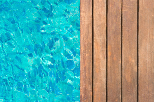 wooden platform at swimming pool with text space