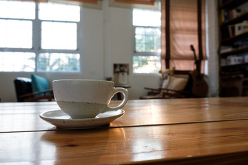 A cup on wooden table in coffee shop