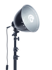Photographic studio light with tripod on white background