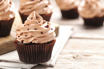 Tasty cupcakes on a grey wooden table