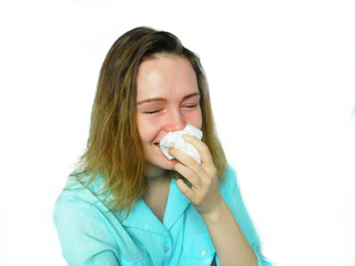 An emotional girl is wiping her nose with a handkerchief