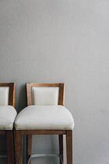 white chair vintage in the living room , modern design interior with grey wall