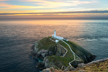 South stack lighthouse on Holy Island in Wales at sunset