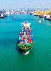 container ship in import export and business logistic.By crane ,Trade Port , Shipping.cargo to harbor.Aerial view.Top view.