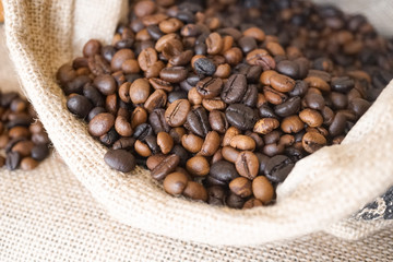 Coffee beans in a coffee sack bag (burlap bag) with soft window light
