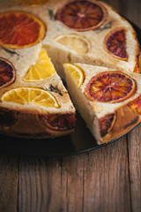 home made citrus cake on wooden table in rustic style