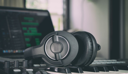 Headphone on a music keyboard in home mmsuic studio