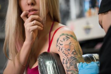 Sexy blonde posing in tattoo studio