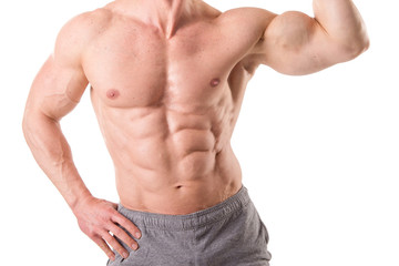 fit muscular man posing isolated in white