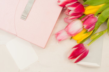Bouquet of tulips,  gift box and blank greeting card