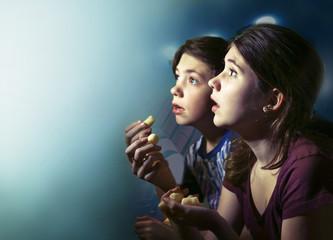 teens boy and girl watching horror movie film