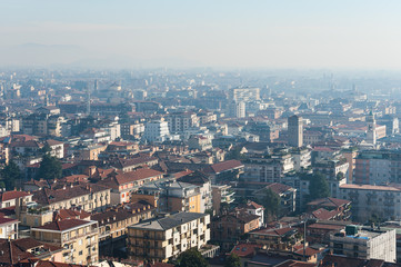 Aerial view on foggy Bergamo town, Lombardy, Italy