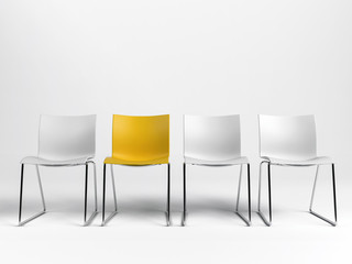 Line of three white and one yellow chairs Fototapete