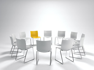 Leadership concept with a single yellow chair