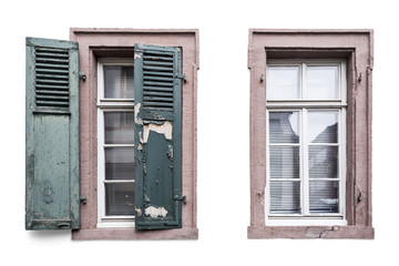 Two old windows, one with wooden shutters and flaking off paint and another one without. Isolated on white background with shadows and clipping path