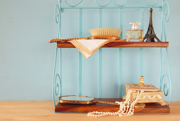 Classic shelf with vintage objects on wooden table