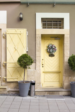 christmas wreath on the yellow door