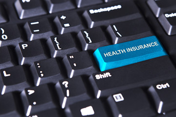 Text of health insurance on the keyboard