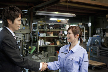 Young Woman Shaking Boss'S Hand