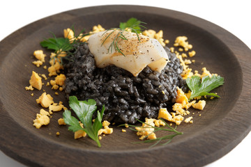 Black squid ink risotto with grilled calamary