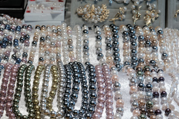 Pearls necklace / View of various pearls necklace on shelf.